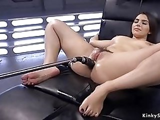 Full-Bosomed babe oils rear and fucks machine