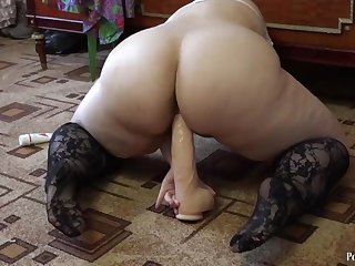 A young fat woman is planted on a huge dildo, shakes a big asshole. HD