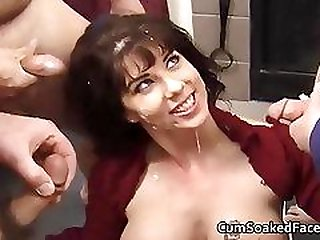 Busty MILF taking cum loads off many guys at private bukkake