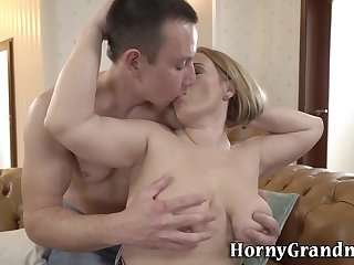Buxom mature woman sucks