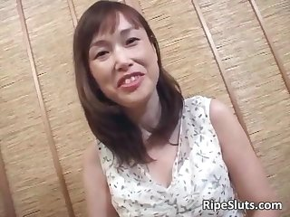 Hot mature Asian slut gets hairy pussy