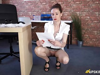 Secretary cleans up and flashes her pussy