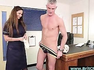 Naughty CFNM British nurse gives handjob to naked guy