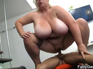 Huge titted plumper rides a thing cock easy