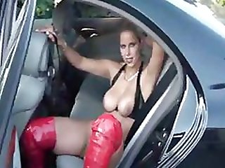 Sexy blonde in red boots sticks her dildo in her pussy in the car