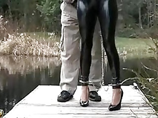 leashed bondage doll walked in latex catsuit