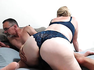 A mature BBW dressed in blue lingerie uses dildo on couch