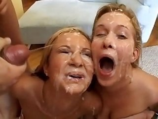 Two girls share a lot of cumshots in bukkake