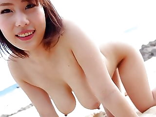 Voluptuous Japanese Girl Mika Utada Has a nude beach adventure